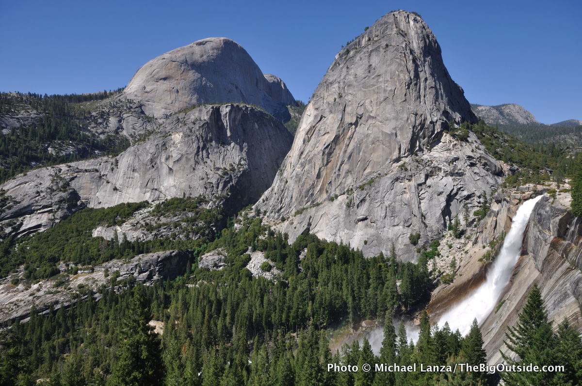 A view from the John Muir Trail of Half Dome, Liberty Cap, and Nevada Fall in Yosemite National Park.