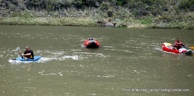 Rescuing blown-away kayak.