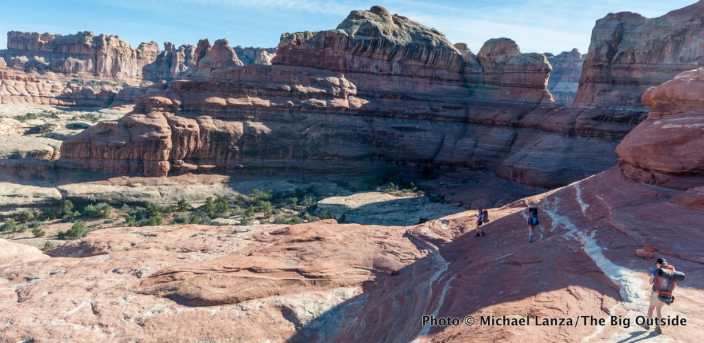 Youths backpacking into Squaw Canyon in the Needles District, Canyonlands National Park.