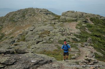 A hiker on Mount Lafayette during a 32-mile dayhike of the Pemi Loop, White Mountains, N.H.