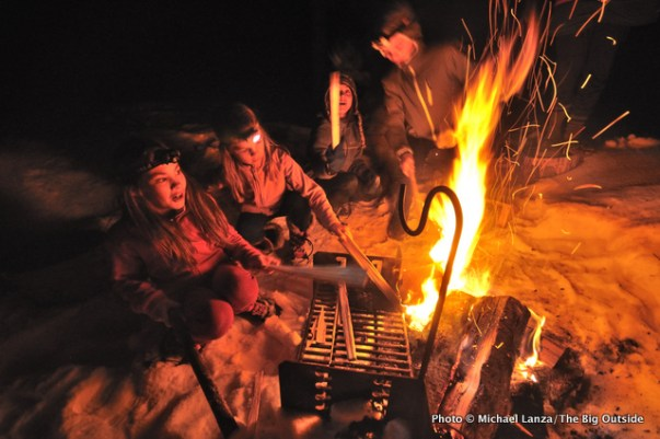 Children around a campfire outside a backcountry yurt in Idaho's Boise National Forest.
