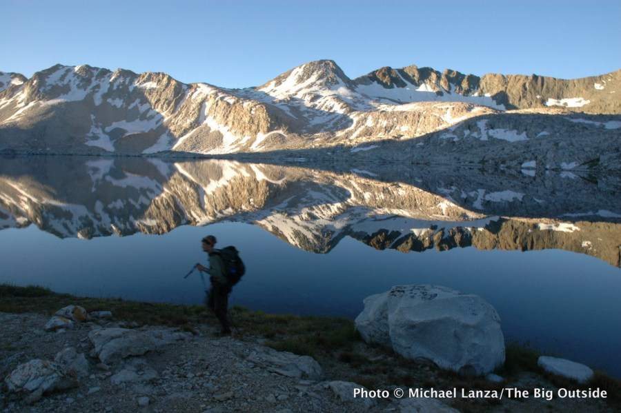 A backpacker passing Wanda Lake on the John Muir Trail in Kings Canyon National Park.