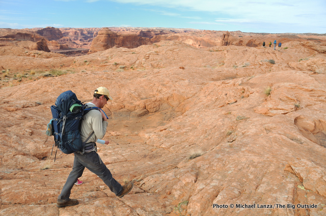 A backpacker hiking to Crack-in-the-Wall.