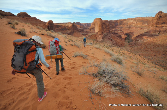 Backpackers descending into Utah's Coyote Gulch.