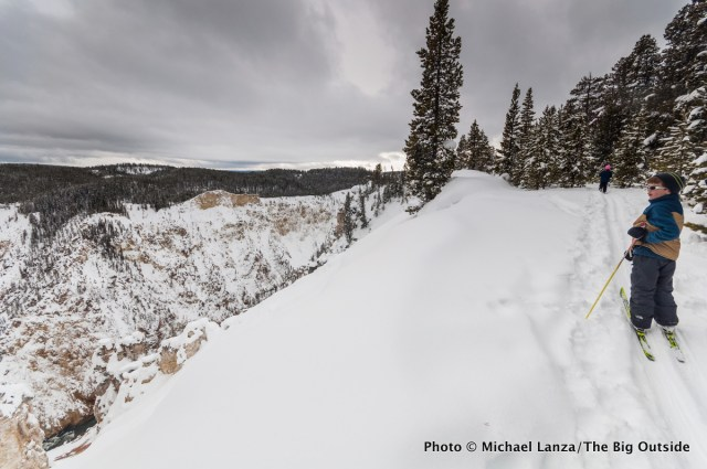 Cross-country skiing the rim of the Grand Canyon of the Yellowstone River, Yellowstone National Park.
