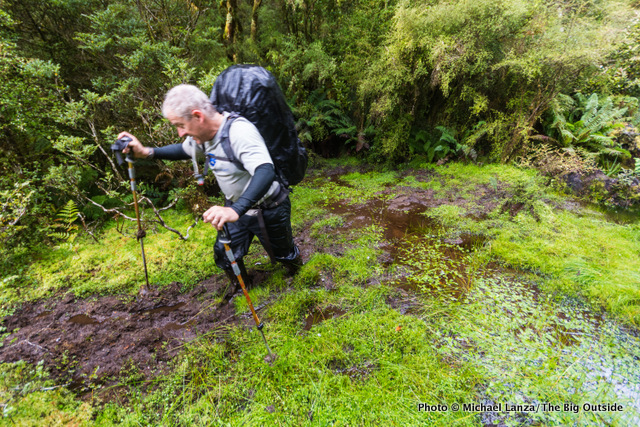Jeff Wilhelm getting muddy on the Dusky Track in New Zealand's Fiordland National Park.