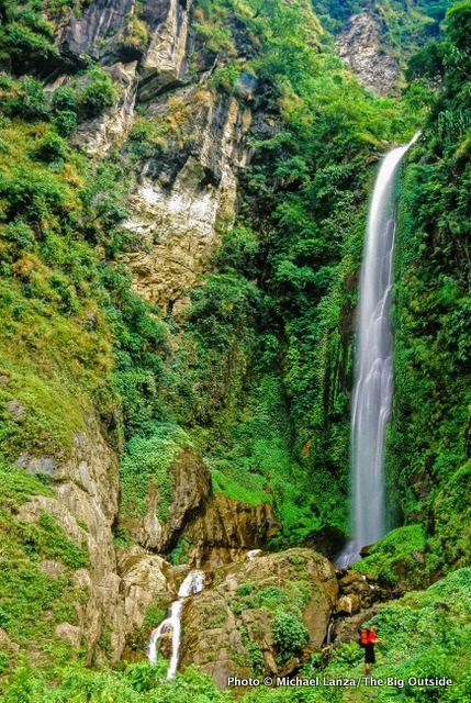 Penny below a waterfall north of Bhul Bhule, Annapurna Circuit, Nepal.