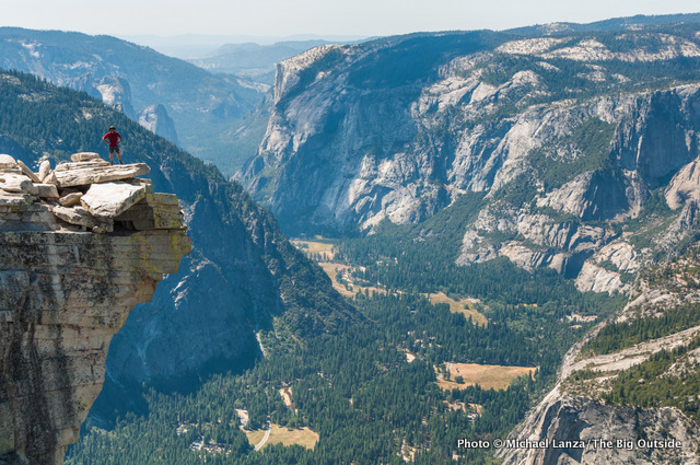 Standing on The Visor on the summit of Half Dome in Yosemite.