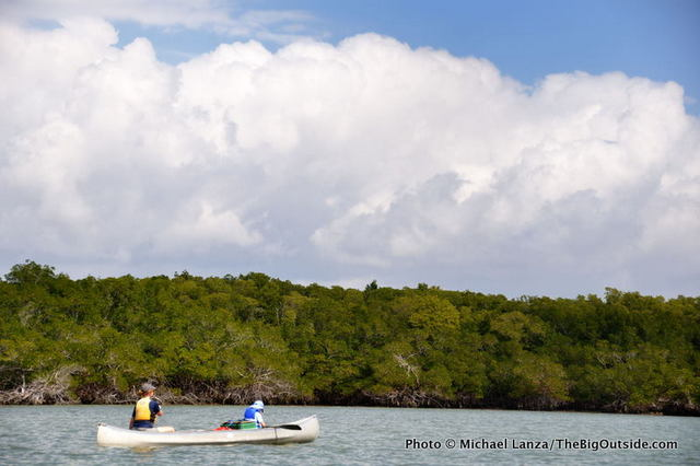 Canoeists paddling through Indian Key Pass, Ten Thousand Islands, Everglades National Park.
