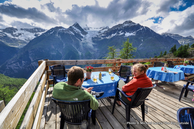Sitting on the deck of the Europa Hut, on the Europa Trail in the Swiss Alps.