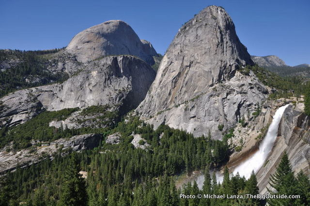 Half Dome (left), Liberty Cap, and Nevada Fall, seen from the John Muir Trail in Yosemite National Park.