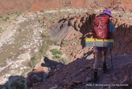 My daughter with the Osprey Ace 38 in Paria Canyon.