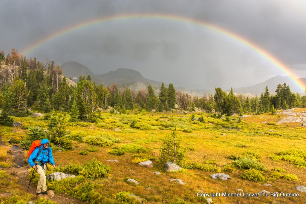 Backpacking in the rain, under a rainbow, in Wyoming's Wind River Range.