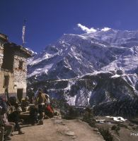Trekkers outside a teahouse on Nepal's Annapurna Circuit.