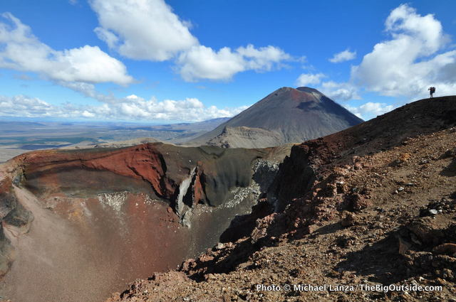 A hiker at the rim of Red Crater, Tongariro National Park, New Zealand.