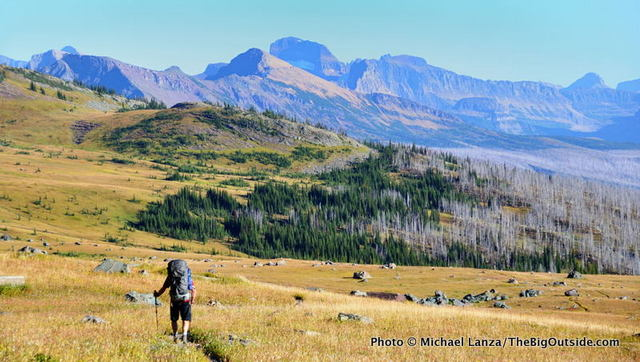 A backpacker on the Highline Trail, Glacier National Park.
