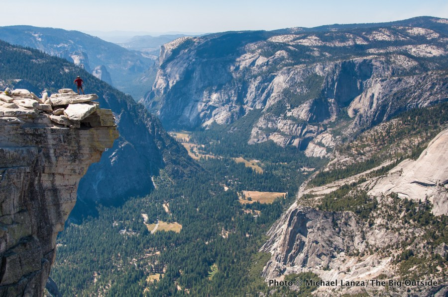 A hiker on Half Dome in Yosemite National Park.