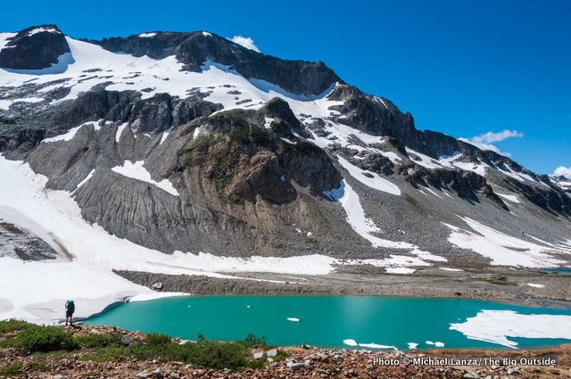 A backpacker at Upper Lyman Lakes, Glacier Peak Wilderness, Washington.