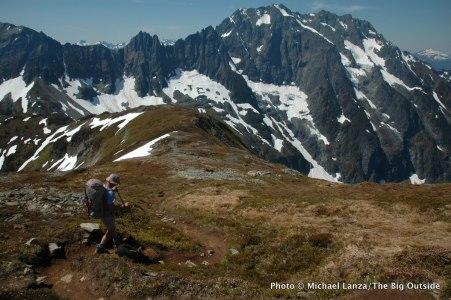 A backpacker hiking Sahale Arm, North Cascades National Park.