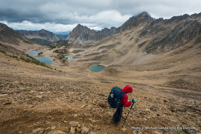 A teenager backpacking into the Four Lakes Basin in Idaho's White Cloud Mountains.