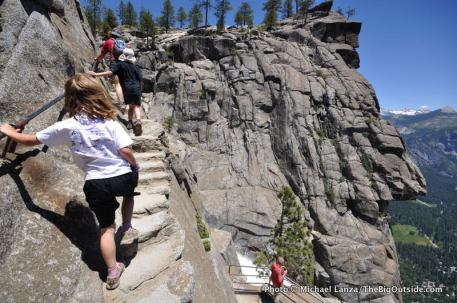 Young children hiking near the brink of Upper Yosemite Falls in Yosemite National Park.