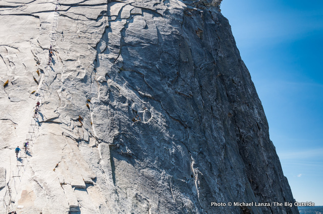 Hikers on Half Dome's cable route in Yosemite.