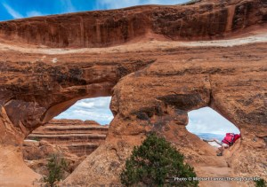 A hiker in Partition Arch, Devils Garden, Arches National Park.