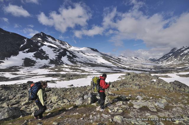 Hikers trekking hut-to-hut across Norway's Jotunheimen National Park.