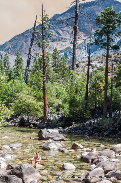 A backpacker cooling off in the Grand Canyon of the Tuolumne River, Yosemite.