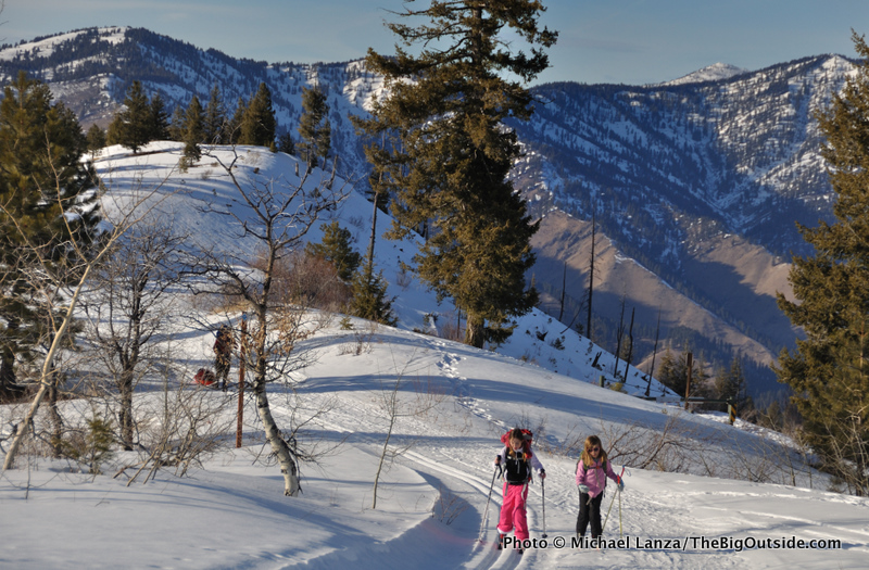 Young girls cross-country skiing to a backcountry yurt in Idaho's Boise National Forest.