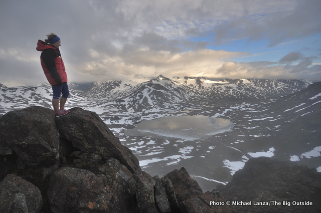 Hiker on the summit of Kyrkja in Norway's Jotunheimen National Park.