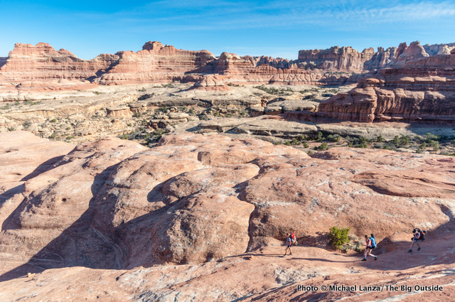 Backpackers in Squaw Canyon, Needles District, Canyonlands National Park.
