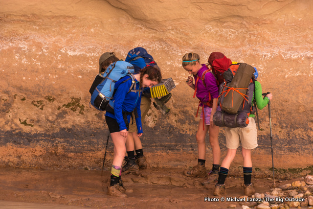 "Kids playing in ""quicksand"" mud while backpacking Paria Canyon."