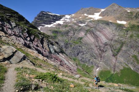 A backpacker on the Gunsight Pass Trail in Glacier National Park.