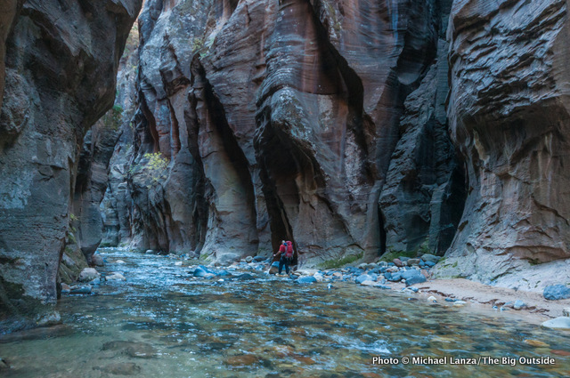 A backpacker in the Wall Street section of Zion's Narrows.