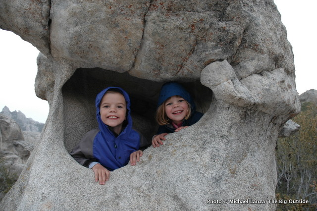 My kids inside a favorite rock formation at Idaho's City of Rocks.