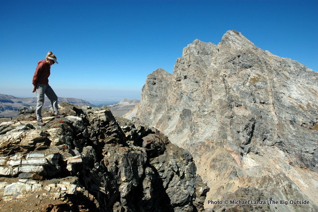 A hiker on the summit of Static Peak, Grand Teton National Park.