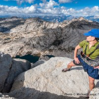 A hiker on the summit of Mount Hoffmann in Yosemite National Park.