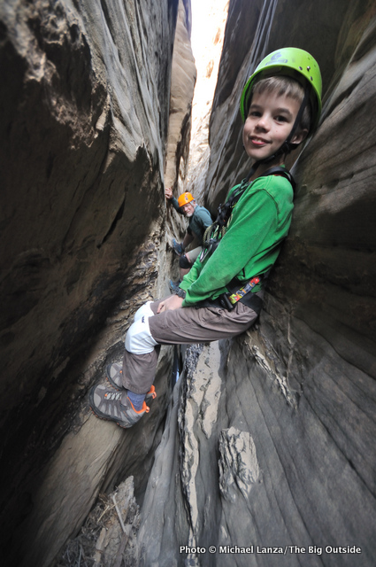 Child in a slot canyon in Capitol Reef National Park.