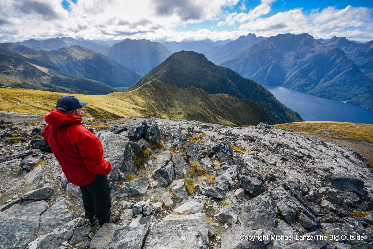 A hiker on Mount Luxmore on the Kepler Track, Fiordland National Park, New Zealand.