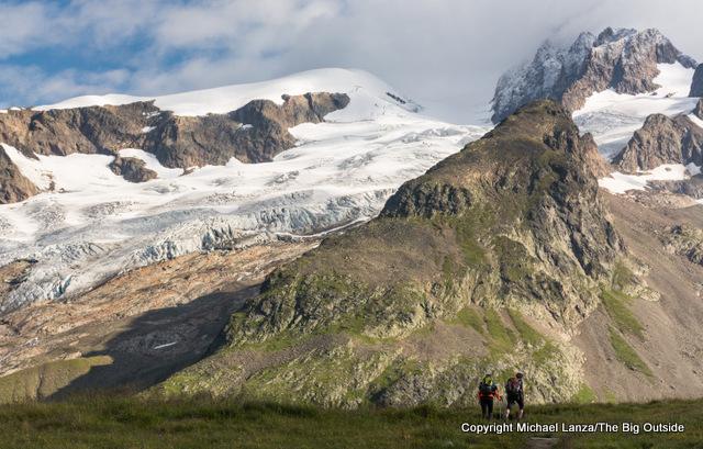 Trekkers hiking to the Col de la Seigne on the Tour du Mont Blanc in France.