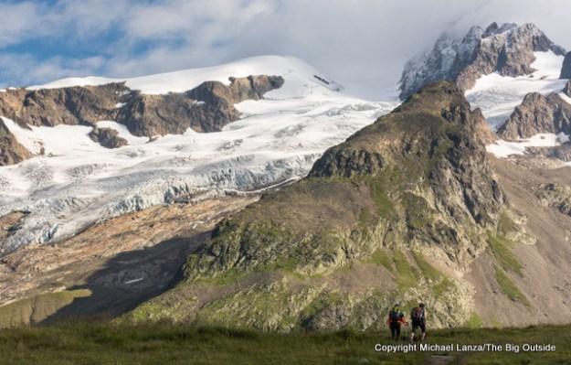 Trekkers hiking to Col de la Seigne, Tour du Mont Blanc, France.