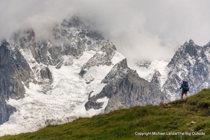 A hiker trekking the Tour du Mont Blanc toward Courmayeur, Italy.