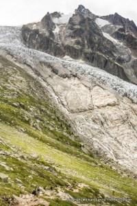 Trekkers by the Glacier du Trient, Tour du Mont Blanc, Switzerland.