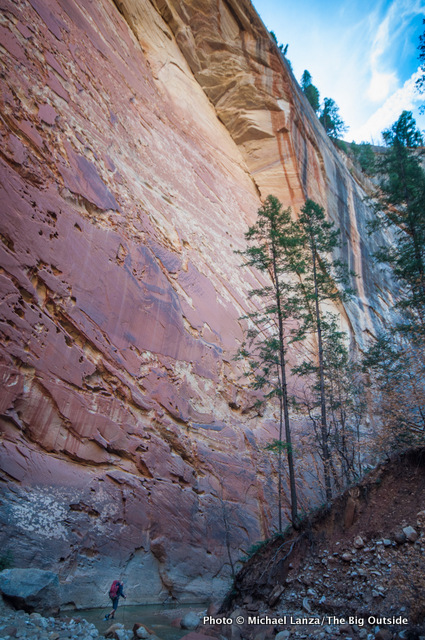 A backpacker on day one in The Narrows, Zion National Park.