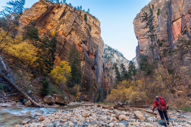 A backpacker in The Narrows, Zion National Park.