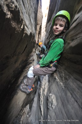 Young boy and man in a slot canyon in Capitol Reef National Park.