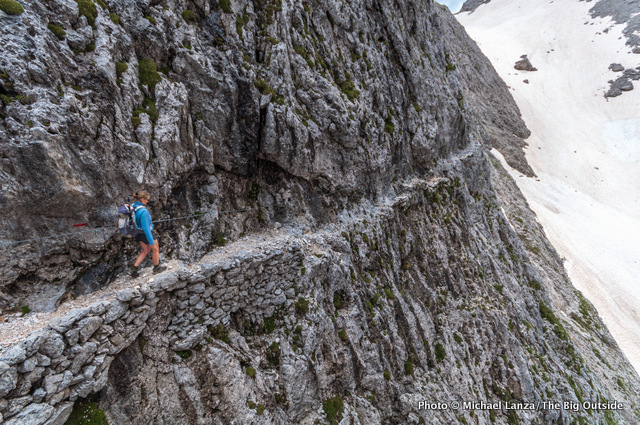 A hiker on the Alta Via 2 in Parco Naturale Paneveggio Pale di San Martino, Dolomite Mountains.