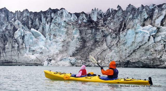 Mother and young daughter sea kayaking in Glacier Bay National Park.