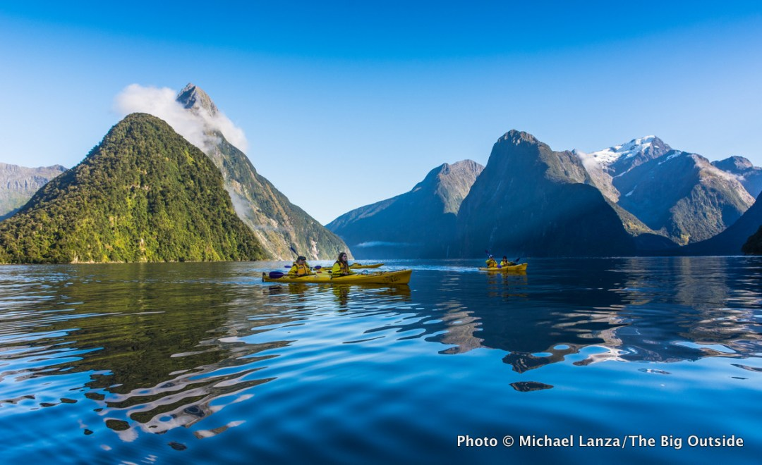 Kayakers paddling Milford Sound in Fiordland National Park, New Zealand.